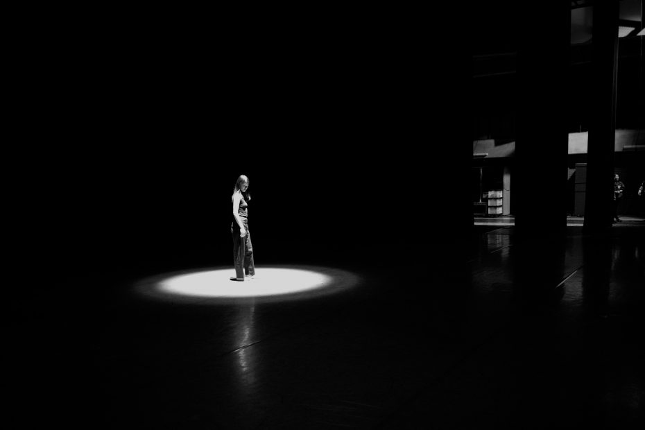 woman-on-stage-in-spotlight